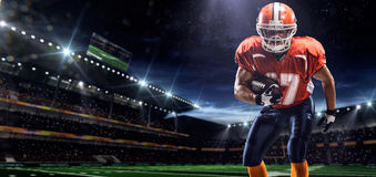 American football sportsman player in stadium. American football sportsman player in olympic stadium royalty free stock photography