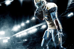 American football sportsman player on stadium running in action Royalty Free Stock Images
