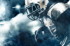 American football sportsman player on stadium running in action Royalty Free Stock Photos
