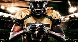 American football sportsman player on stadium. Sport wallpaper. American Football player on stadium with smoke and lights royalty free stock photography