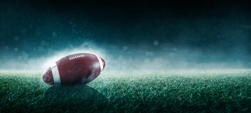 American football is on stadium stock images