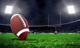 American football in stadium at night Royalty Free Stock Photos