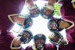 American Football Team having huddle in match Stock Photos