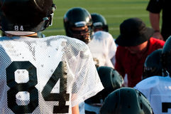 American football team in huddle Royalty Free Stock Photo