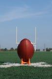 American Football teed up for kickoff stock photo