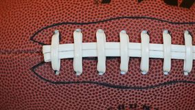 American Football Time. Real leather American football closeup stock video footage