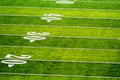 American Football Turf. Football field green painted numbers 20 30 40 lines super bowl college professional championship fantasy gambling wager gridiron pigskin Royalty Free Stock Photography