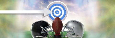 American football versus teams helmets with target and arrow and ball. Digital composite of American football versus teams helmets with target and arrow and ball Royalty Free Stock Photo