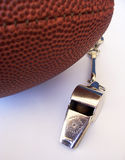 American Football and whistle. Photo of an American football and coaches whistle Stock Photography