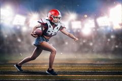 American football woman player in action. athlete in equipment. American football woman player in action at the stadium. athlete in equipment stock images