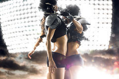American football woman player in action Stock Image
