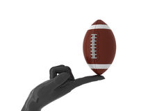 American football for you. American ball on forefinger. Isolated Stock Images