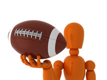 American football for you. Orange mannequin with american ball. Isolated Royalty Free Stock Image