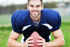 American footballer holding ball Royalty Free Stock Photography