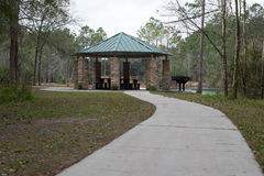 American forest BBQ picnic area in park on lake Stock Photos