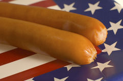 American frankfurters. On paper waiter with american flag on it, detail photo Royalty Free Stock Photo