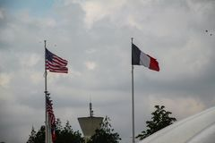 American and French flags in Normandy stock photography