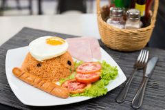 American Fried Rice. With egg ham and sausage on black table Royalty Free Stock Image