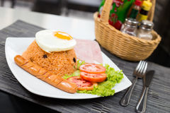 American Fried Rice. With egg ham and sausage on black table Royalty Free Stock Photography
