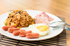 American fried rice with pork sausage, bacon and fried egg Royalty Free Stock Photography