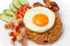 American fried rice with sausages, fried egg, fried chicken, cuc Royalty Free Stock Photography