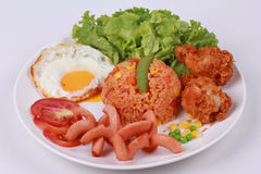 American fried rice topped sunny up,sausage.chicken and herbs Royalty Free Stock Images