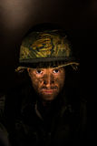 American GI Portrait - PTSD. Close up of an American G.I. from the Vietnam War period, with face covered in dirt and mud Stock Images