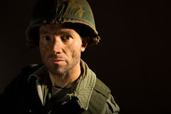American GI Portrait - PTSD. Close up of an American G.I. from the Vietnam War period, with face covered in dirt and mud Royalty Free Stock Photo