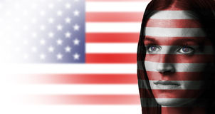 American girl. Portrait of a beautiful girl with USA flag in background Royalty Free Stock Photos