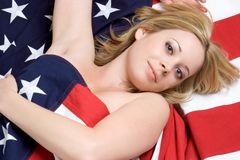 American Girl. Beautiful american girl in flag stock photography