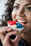 American girl bite cupcake Royalty Free Stock Photography