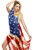 American girl cover herself with a big american flag Royalty Free Stock Photos