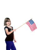 American Girl with Flag. This girl shows her pride by waiving this American Flag Royalty Free Stock Images