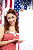 American girl holding blank board. Stock Photos