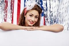 American girl holding blank board. Stock Photo