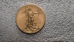 American Gold Eagle Coin on Silver Bar. Back royalty free stock image