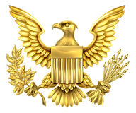 American Gold Eagle. Gold American Eagle Design with bald eagle of the United States holding an olive branch and arrows with American flag shield Stock Photos