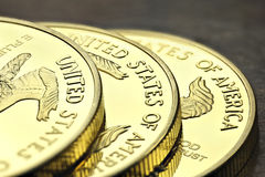 American gold eagle. 1 ounce American gold eagle bullion coins on wooden background stock photography