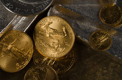 American Gold Eagle & Silver Eagle Coins with Silver Bars Royalty Free Stock Photo