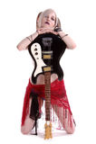 American Goth Guitar. Goth Rock guitar player kneeling with an electric guitar Stock Image