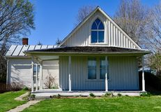 American Gothic House. This is a Spring picture of the iconic American Gothic House, originally known as the Dibble House located in Eldon, Iowa in Wapello Royalty Free Stock Photo