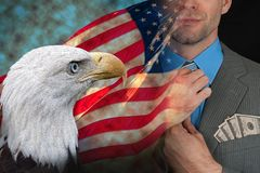 American Greed - Corporate Greed - Government Greed. USA flag and American eagle blended into image of corporate man with money in pocket. Metaphorical. Greed stock photography