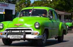 American green classic car on the road. American classic car on the road in cuba havana Royalty Free Stock Photography