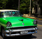 American green classic car on the road in havana. A American green classic car on the road in havana Royalty Free Stock Image