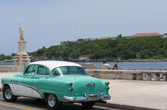 American green white classic parked on the road with view of the fortress el Morro Royalty Free Stock Photography