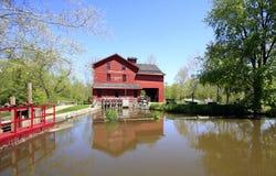 American grist mill. Exterior of Bonneville grist mill overlooking Little Elkhart river, Indiana, U.S.A Stock Photos
