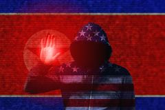 American hacker touching north korean flag Stock Images