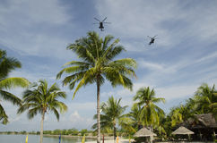 American helicopters flying over the beach Royalty Free Stock Photo