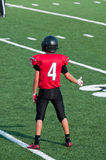American high school football player with thumbs up on the field Stock Photos