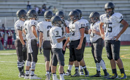 American high school football team. Gathered together on pitch Royalty Free Stock Photos